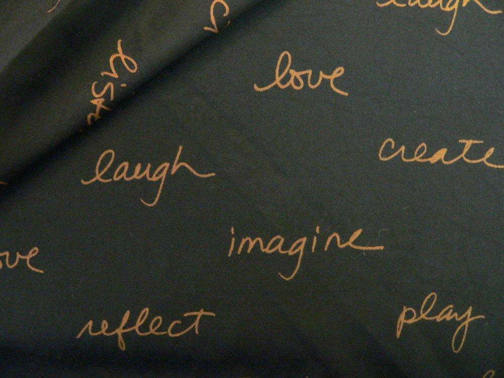 100% rayon batik, black with gold words