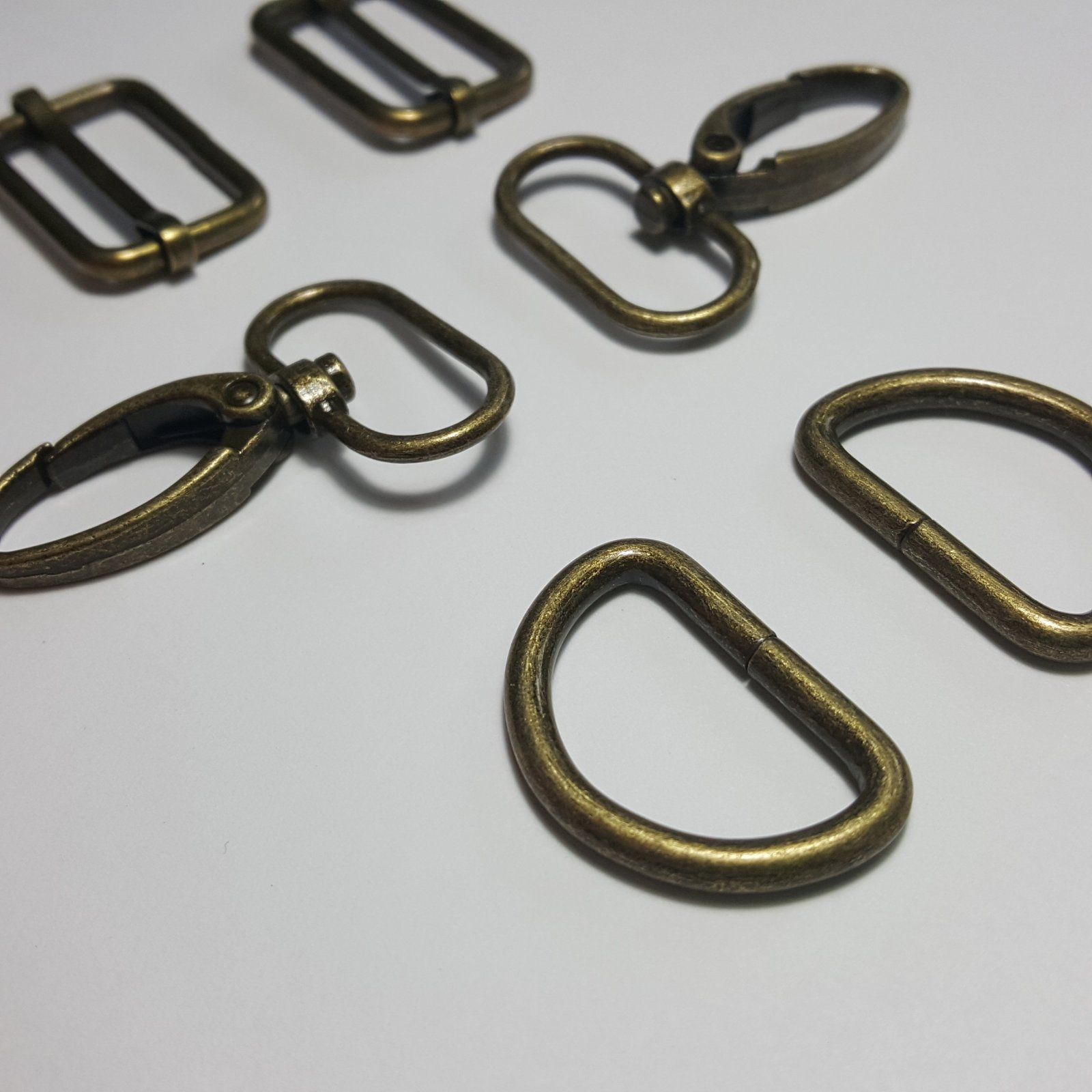 1- 2 D Rings + 2 Slides + 2 Swivels - Brass