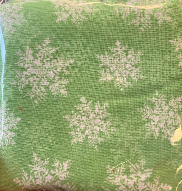 White snowflakes on green charms 42