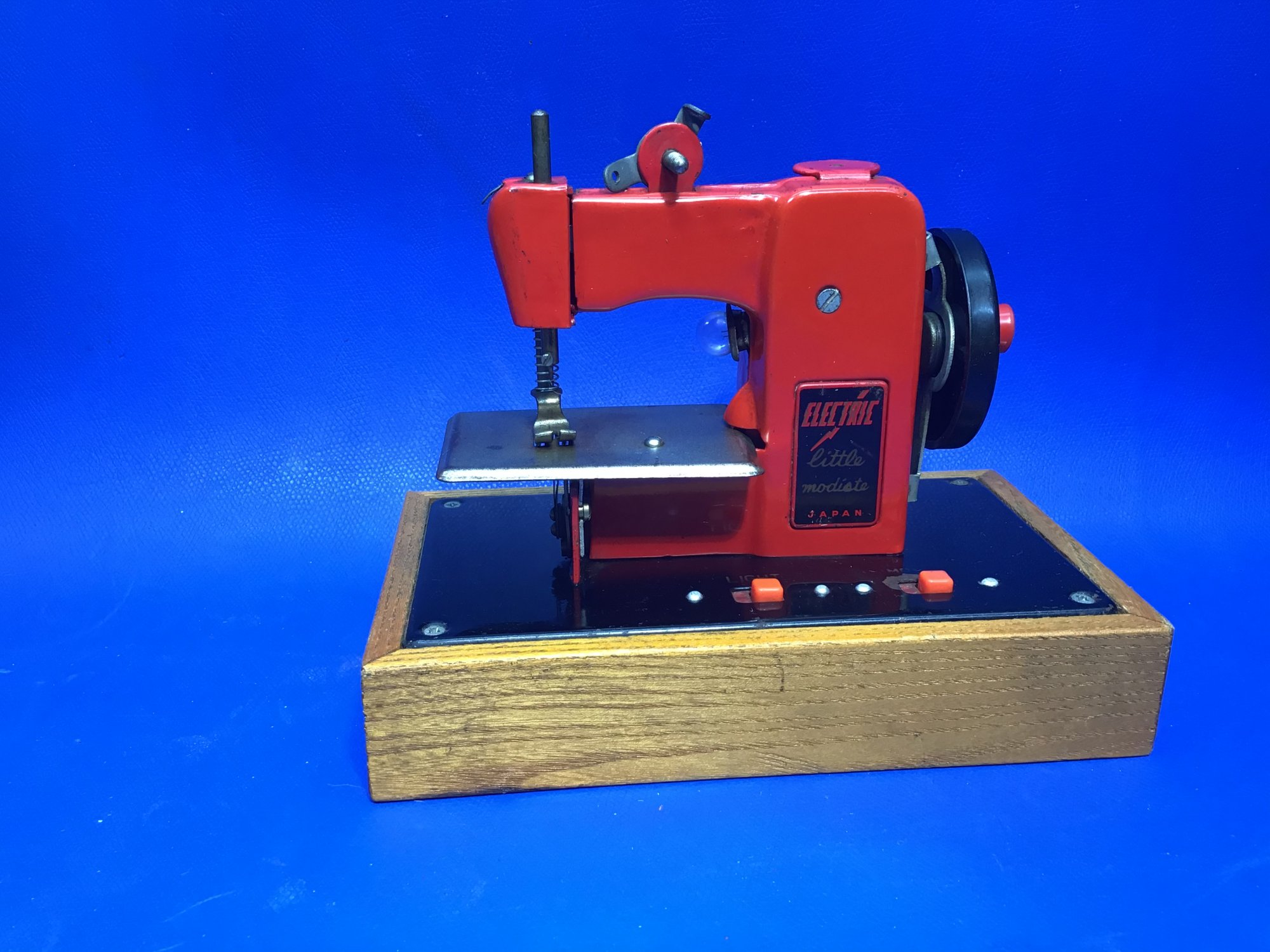 Red and Black Little Modiste Toy Sewing Machine