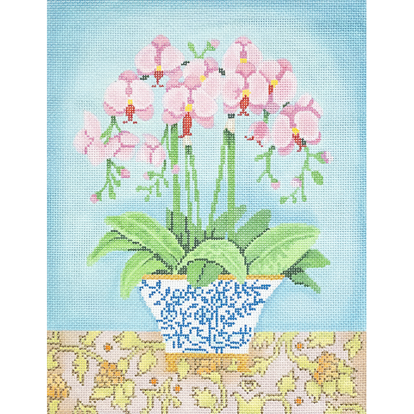 PINK ORCHIDS IN BLUE AND WHITE PLANTER