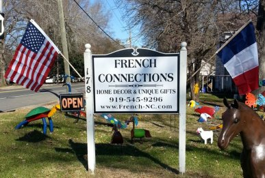 French Connections sign with American and French flags