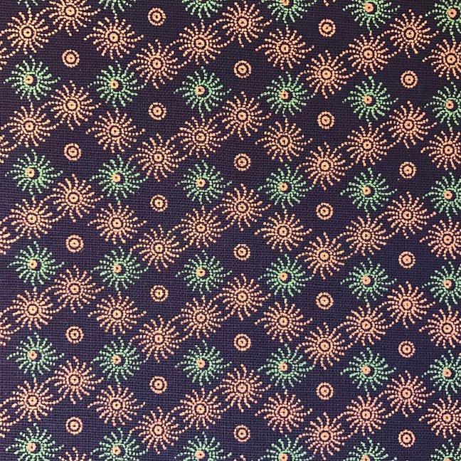 Green and orange geometric swirls on brown shweshwe (0305)