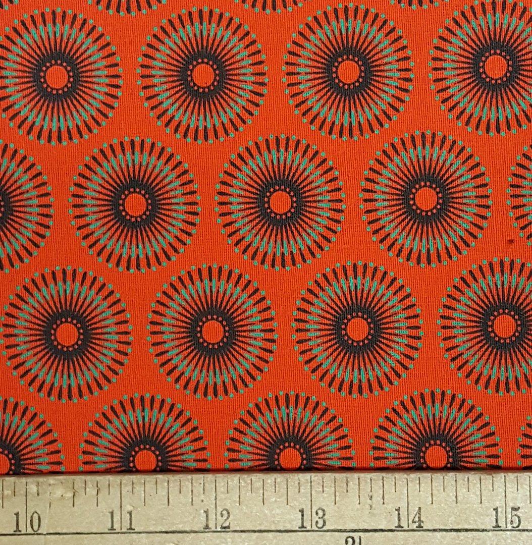 Orange, jade green, and black medallion shweshwe fabric (1406)