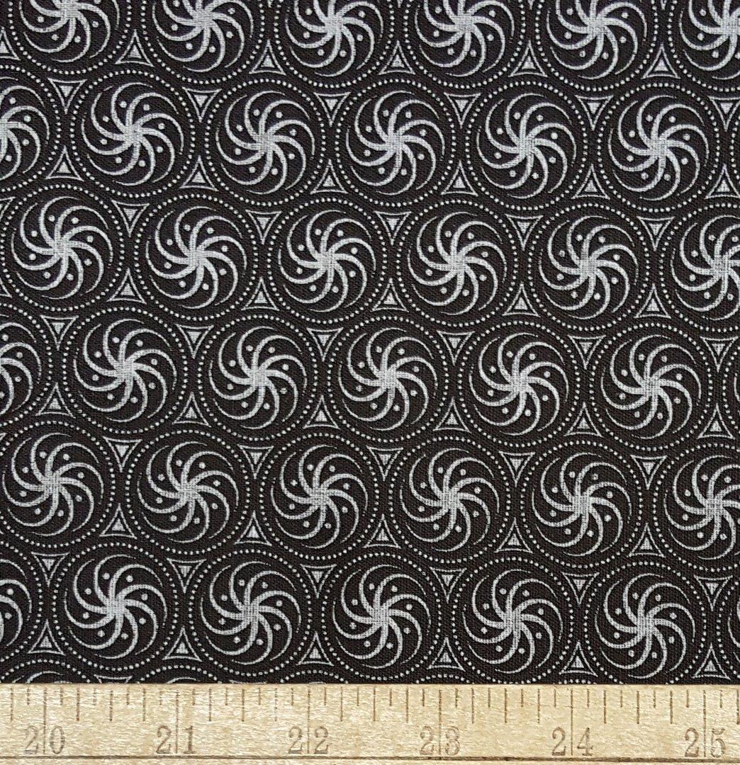 Brown and white swirling stars shweshwe (1408)