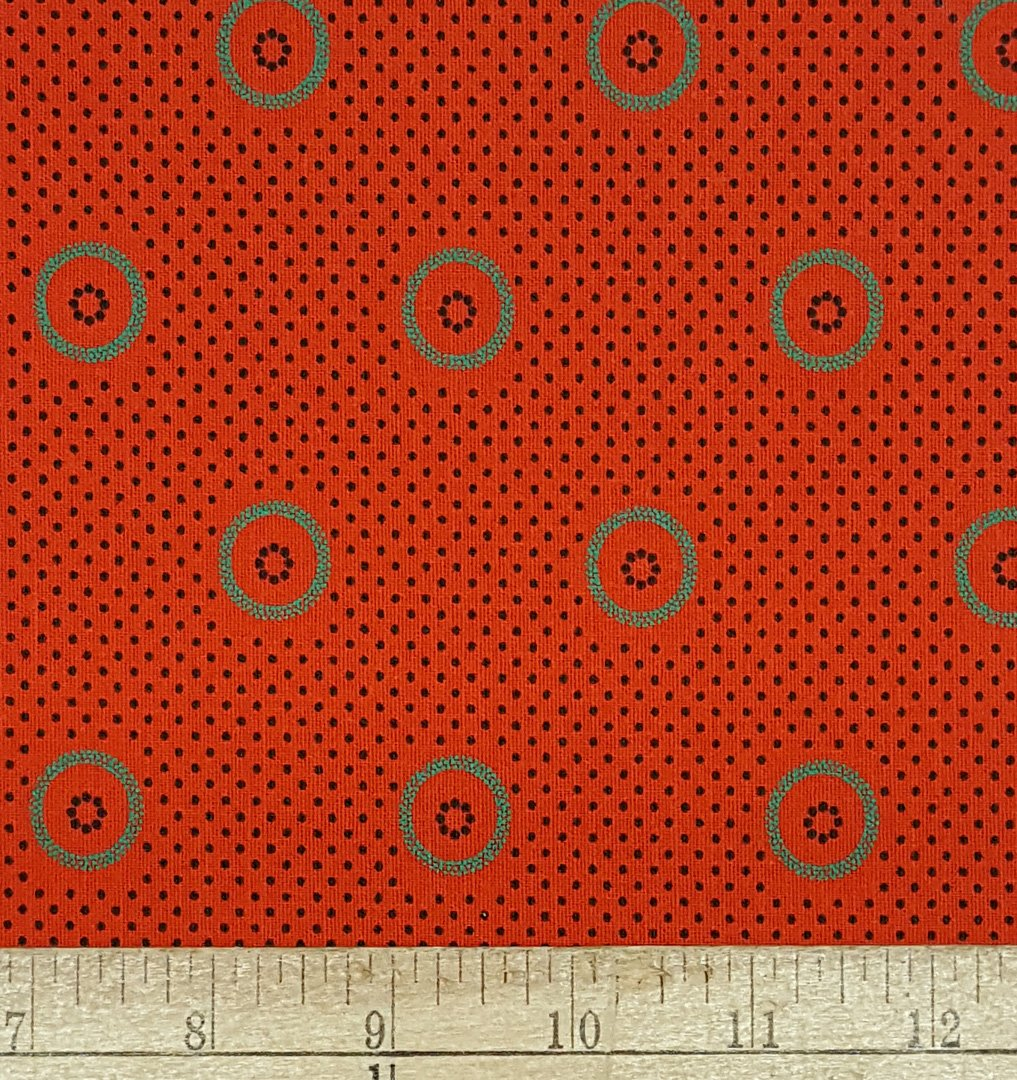 Orange, jade green, and black circle shweshwe fabric (0840)