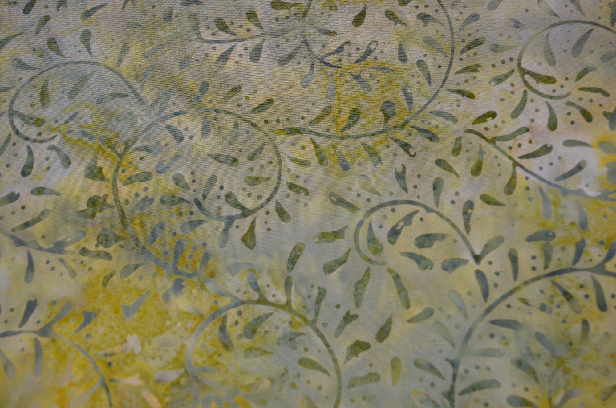 Batavian Batiks Green/Gold Curling Leaves