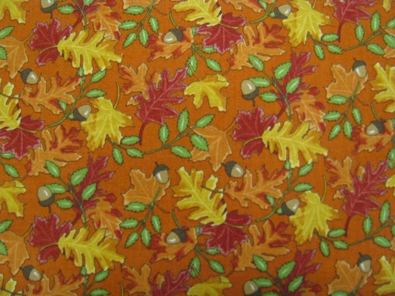 Moda Pumpkin and Spice Leaves on orange