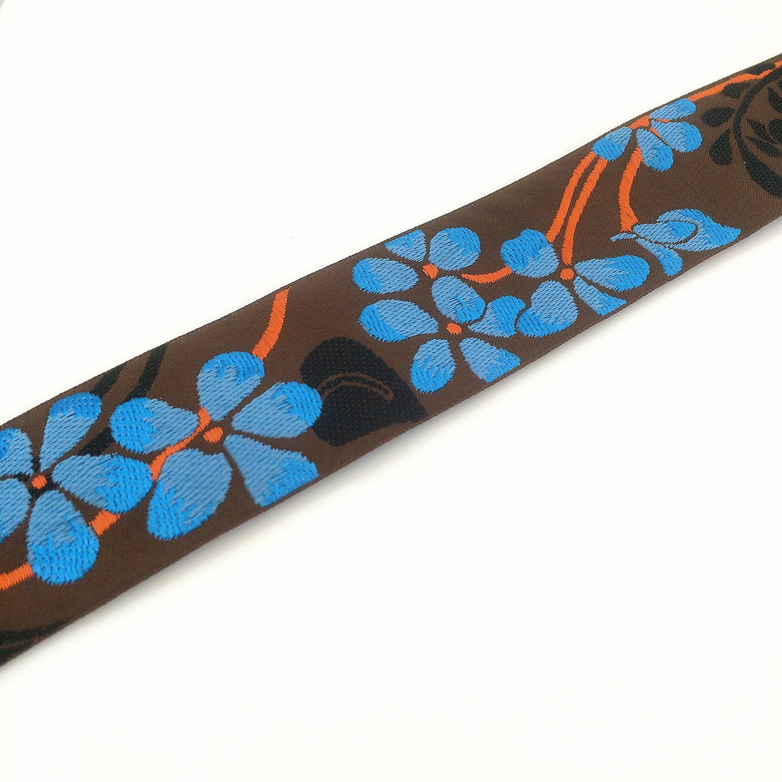 RENAISSANCE RIBBONS - FLOWER - BLUE ON BROWN