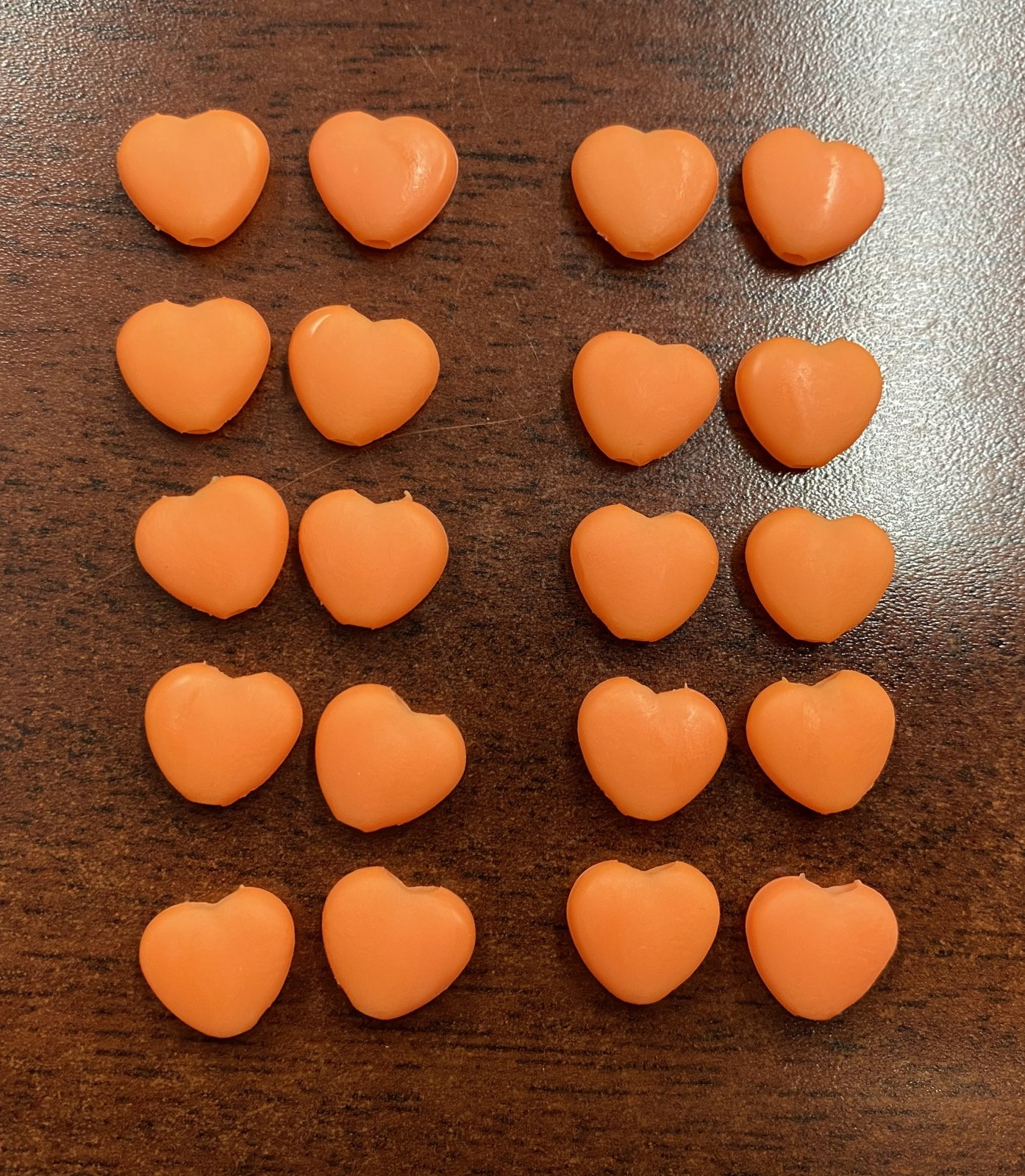 N- Cord Stops Orange Hearts (Pkg of 20)