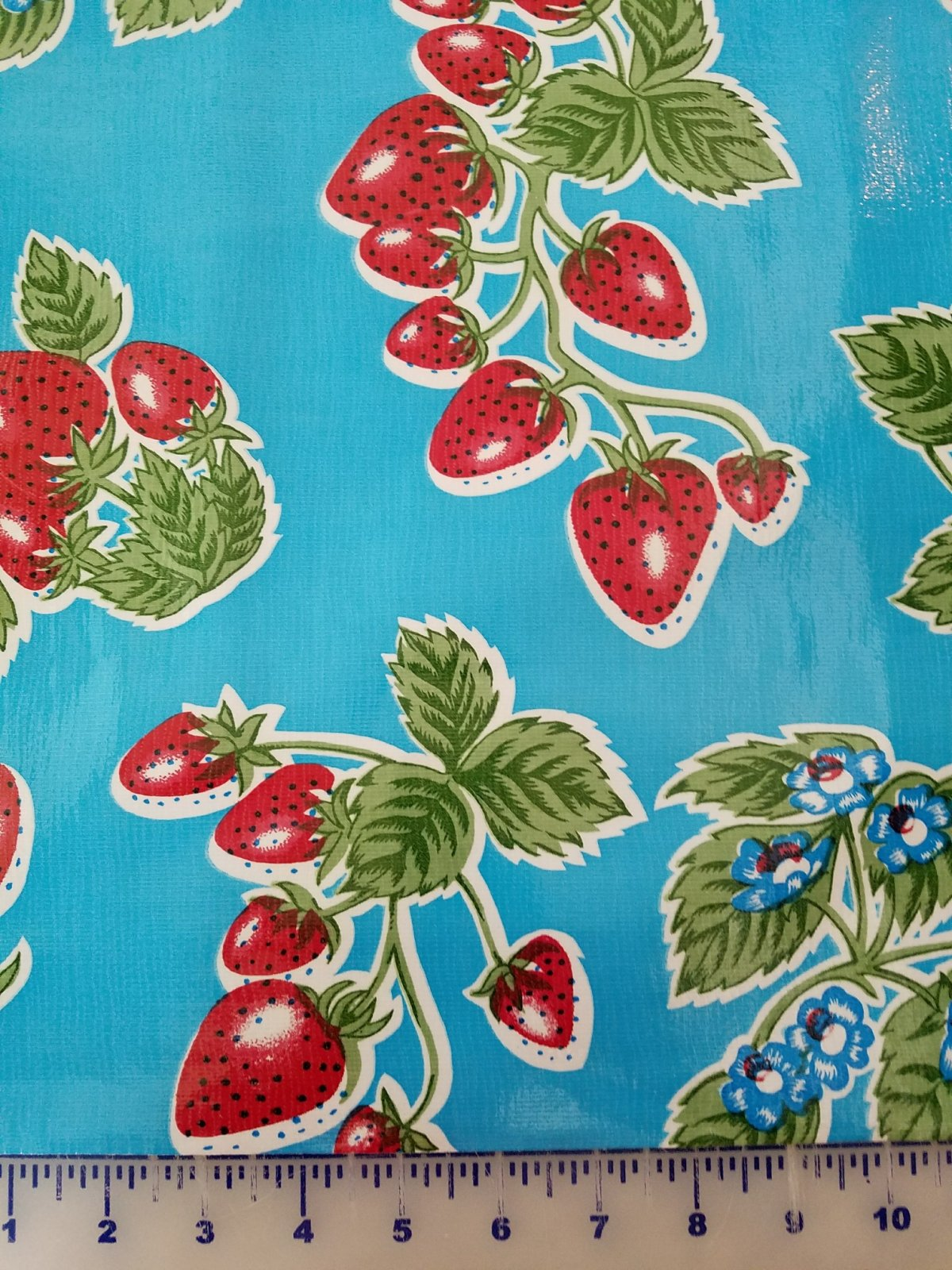 STRPBLUSTRW Moda Oilcloth 48 wide Blue/Strawberry