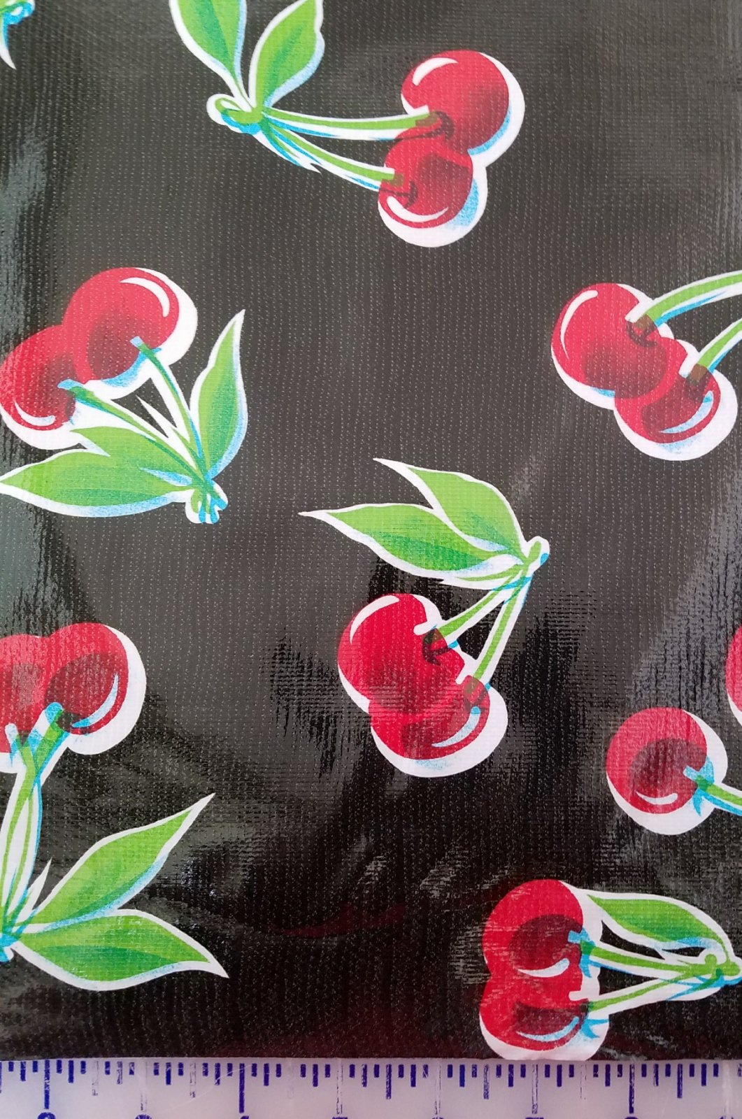 BLKCHERRIE Moda Oilcloth 48 wide Black with Cherries