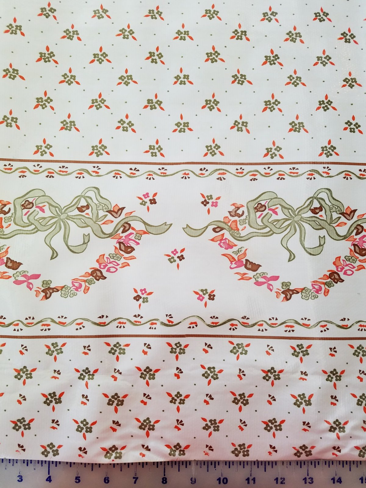 R240 Oilcloth 48 wide Ribbons & Gold Flowers on White