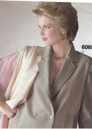 cool undertone lady in taupe suit and pink accents