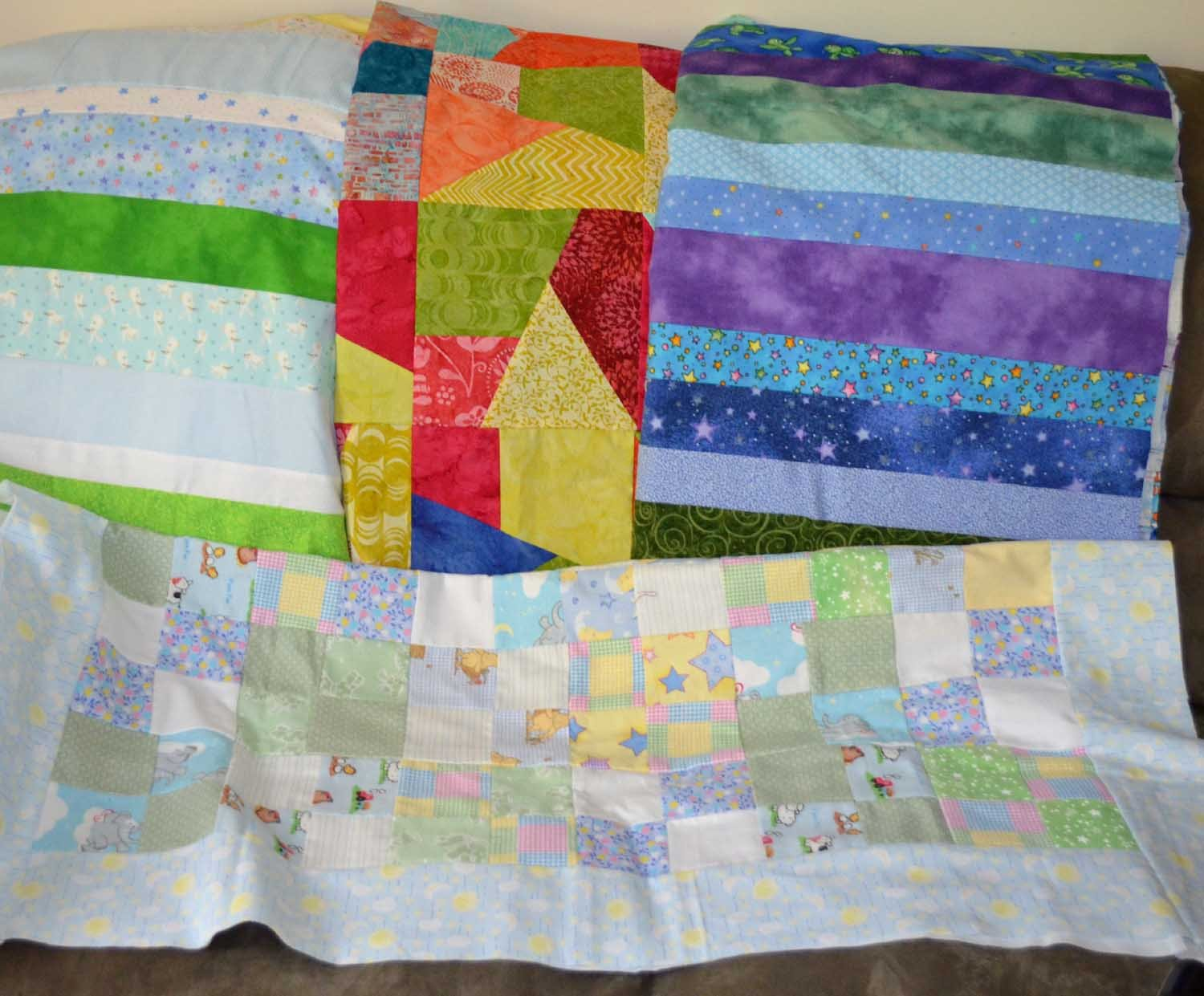 Helping Hands quilt tops