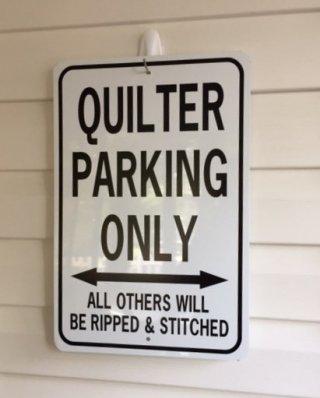 Joyce B's No Parking Sign