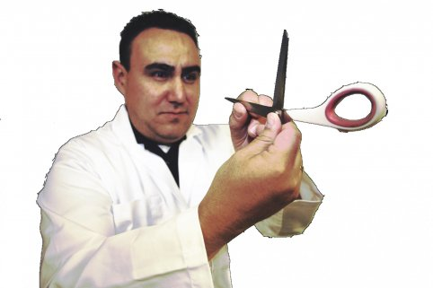 Jeremi Chavez, formerly of Abbey Lane sharpening scissors, pinking shears