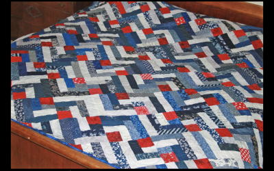 Bed quilt made by Tea and Stitches
