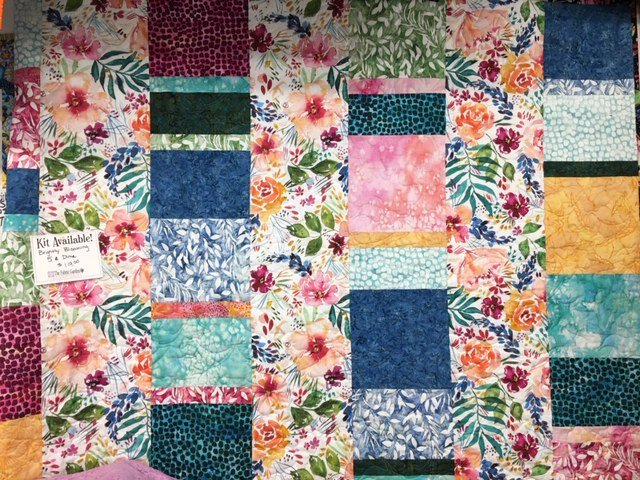 Brightly Blooming  - 5 and Dime Quilt Kit featuring fabrics by Moda