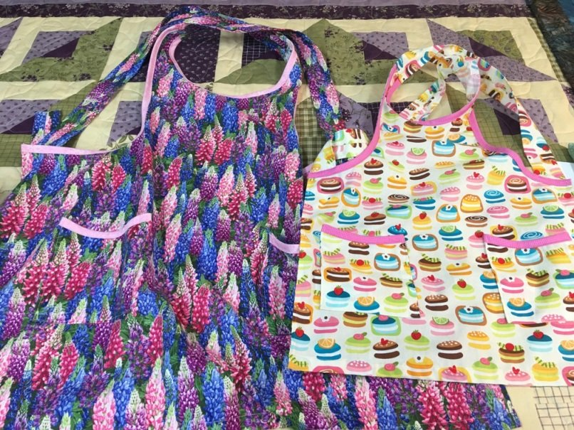 For Sale:  Adult / Child Apron Set - Lupine and Macaron / Cakes