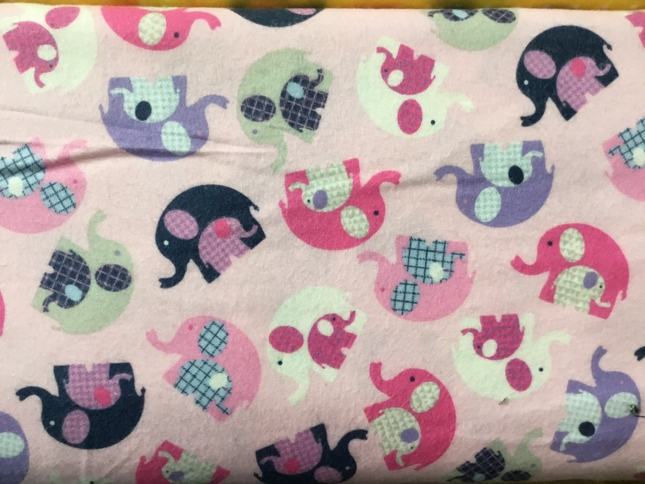 Pink flannel with multi coloured elephamts