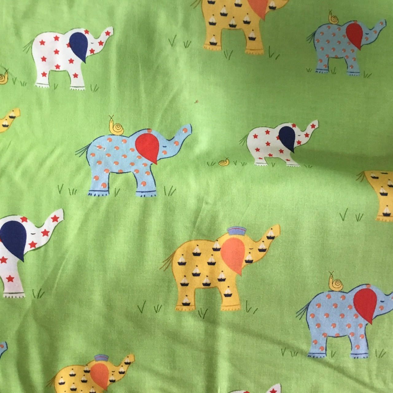 Coloured Elephants on green