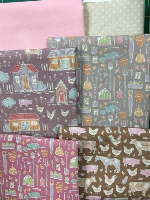 On the Farm with Tilda baby cot quilt pink and grey