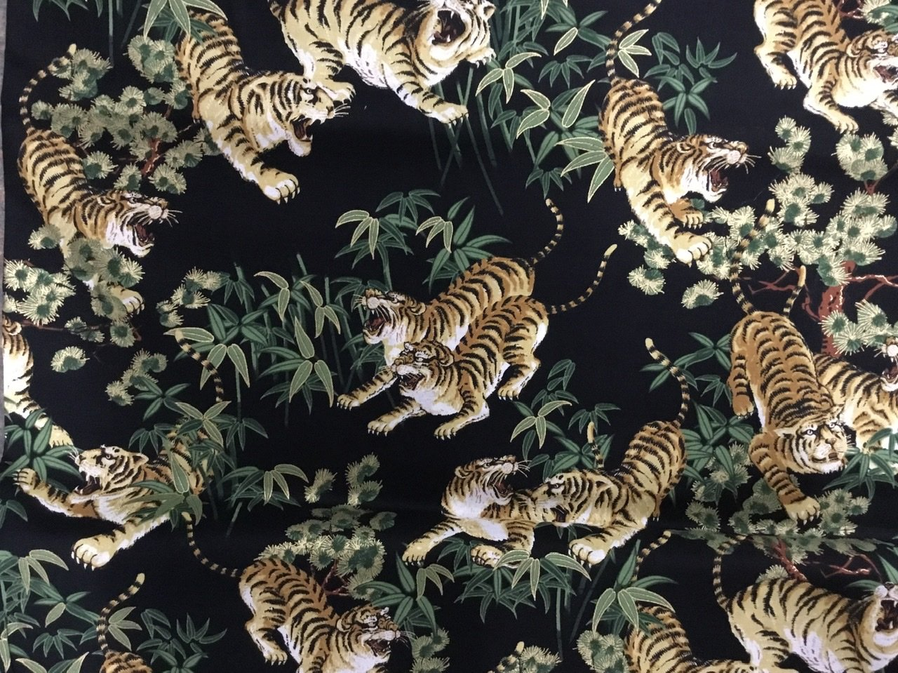 Tigers on black with oriental leaves
