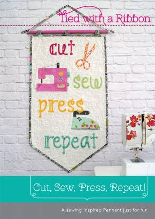 Cut, Sew, Press, Repeat wall pennant by Tied with a Ribbon