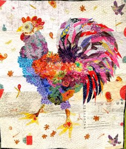 Wall hanging with an image of a rooster made of collaged fabric.