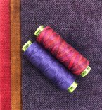 purple wool and thread bundle