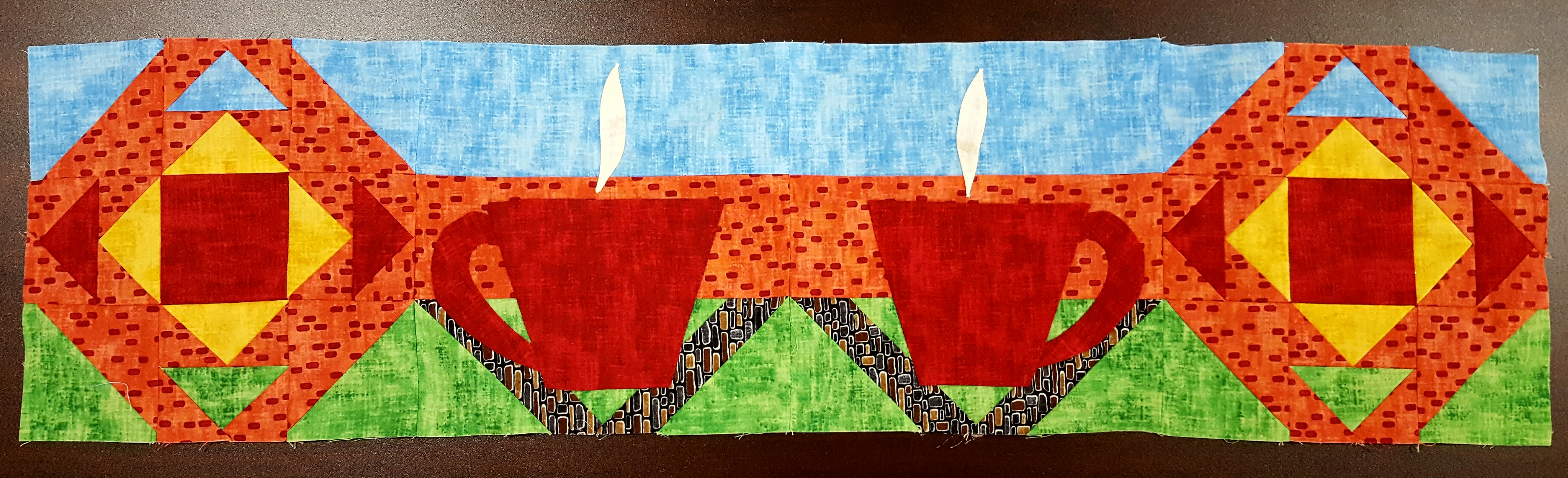 Here's The Quilting Grounds row for Row by Row.  Stop by our shop for your free pattern.