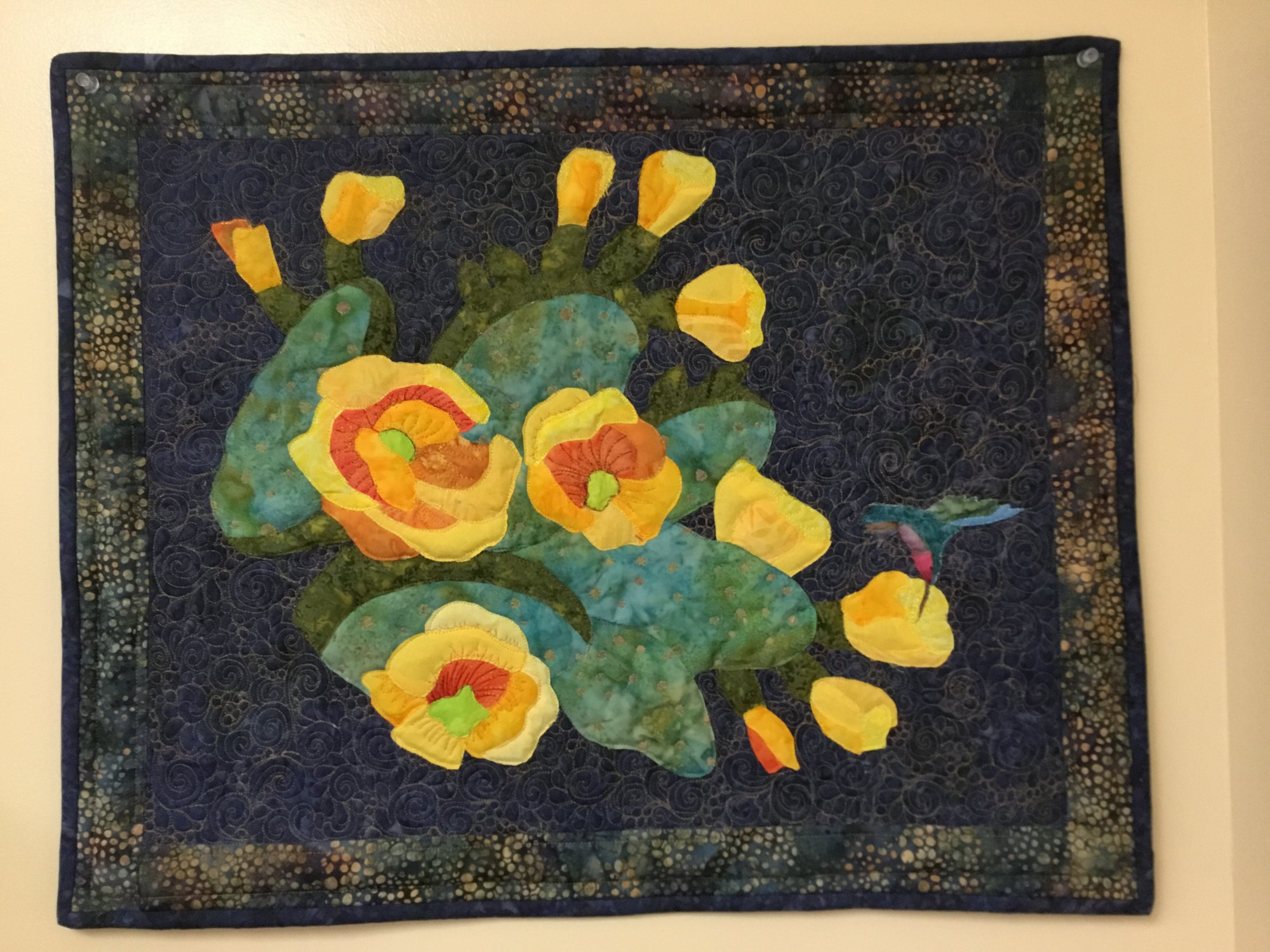 PRICKLY PEAR AND HUMMINGBIRD WALL HANGING Charlotte Gary