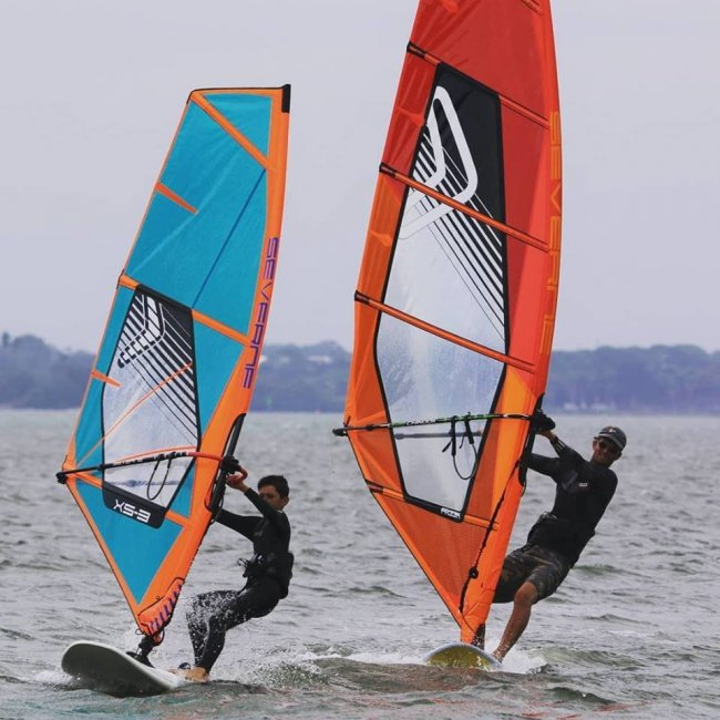 windsurfing dad and son at st pete beach