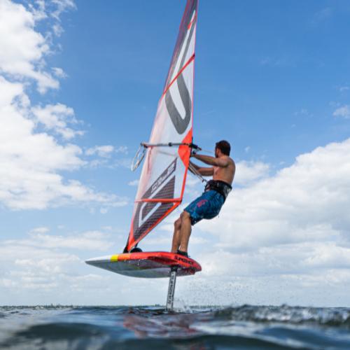 man windsurf foiling in st pete beach florida