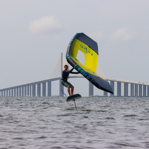 wing foiling in front of skyway