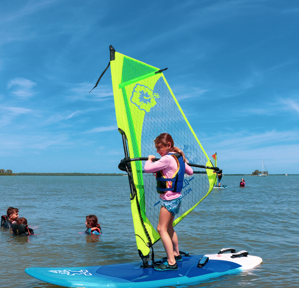 girl learning to windsurf in windsurf lesson
