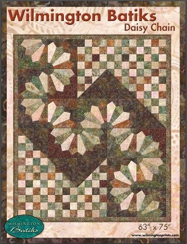 Daisy Chain a unique scrappy batik quilt design with meandering Dresden Fan blocks and 16-patches.