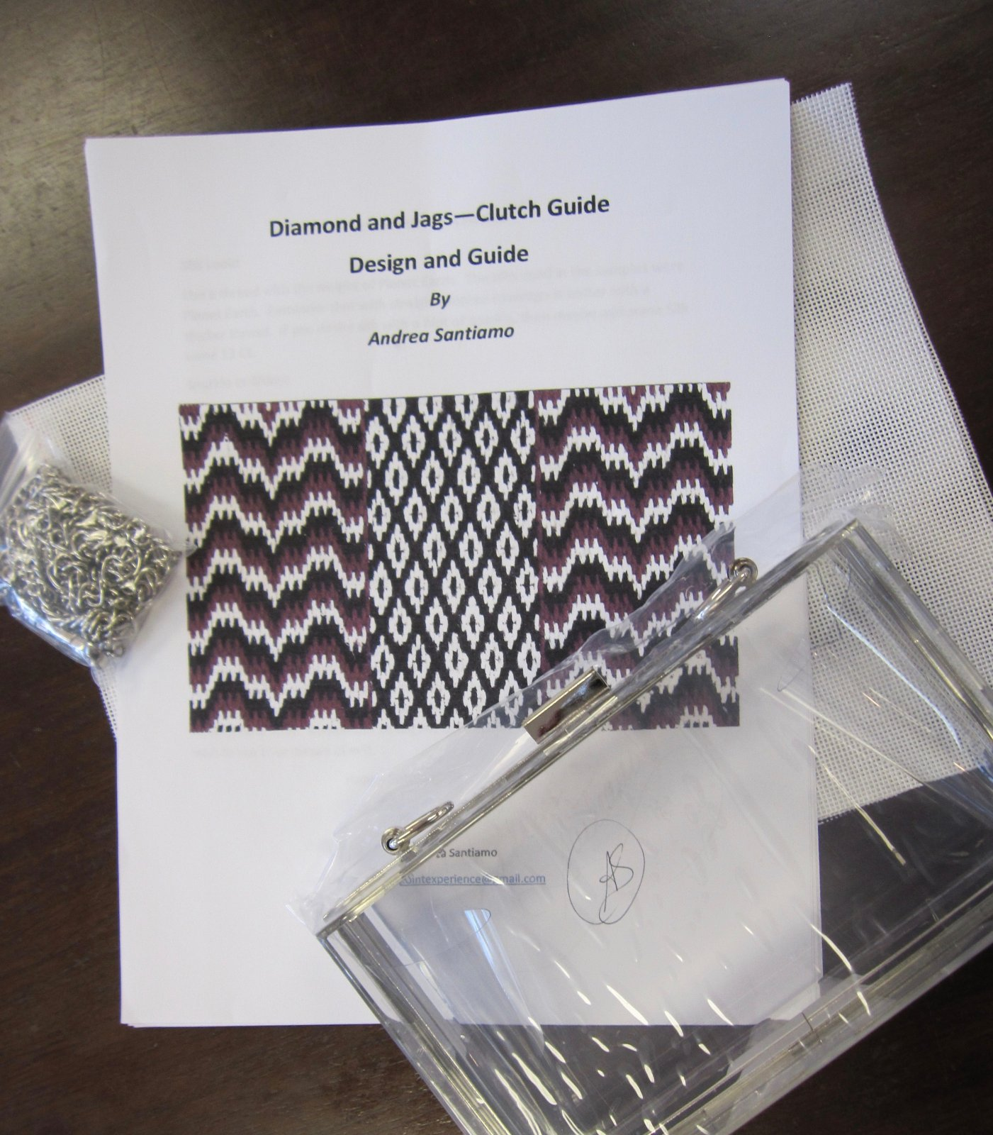 Lucite clutch, Diamond and Jags, silver trim