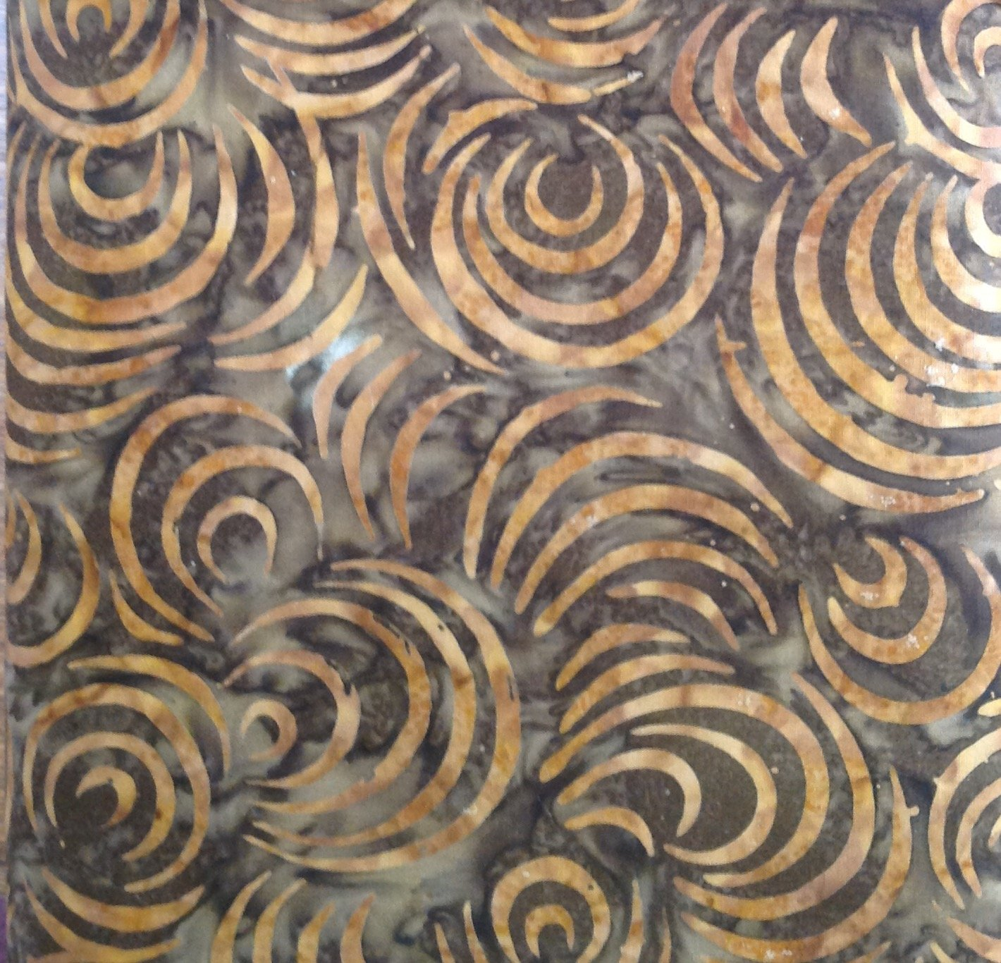 Large Tan Curl on Brown Batik
