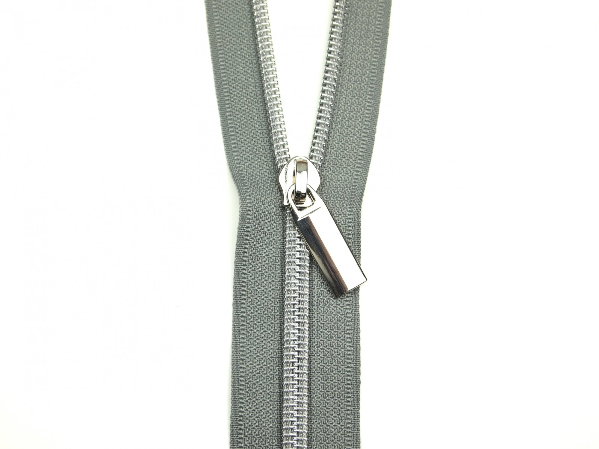 Zipper by the yard GreyTape Nickel coil