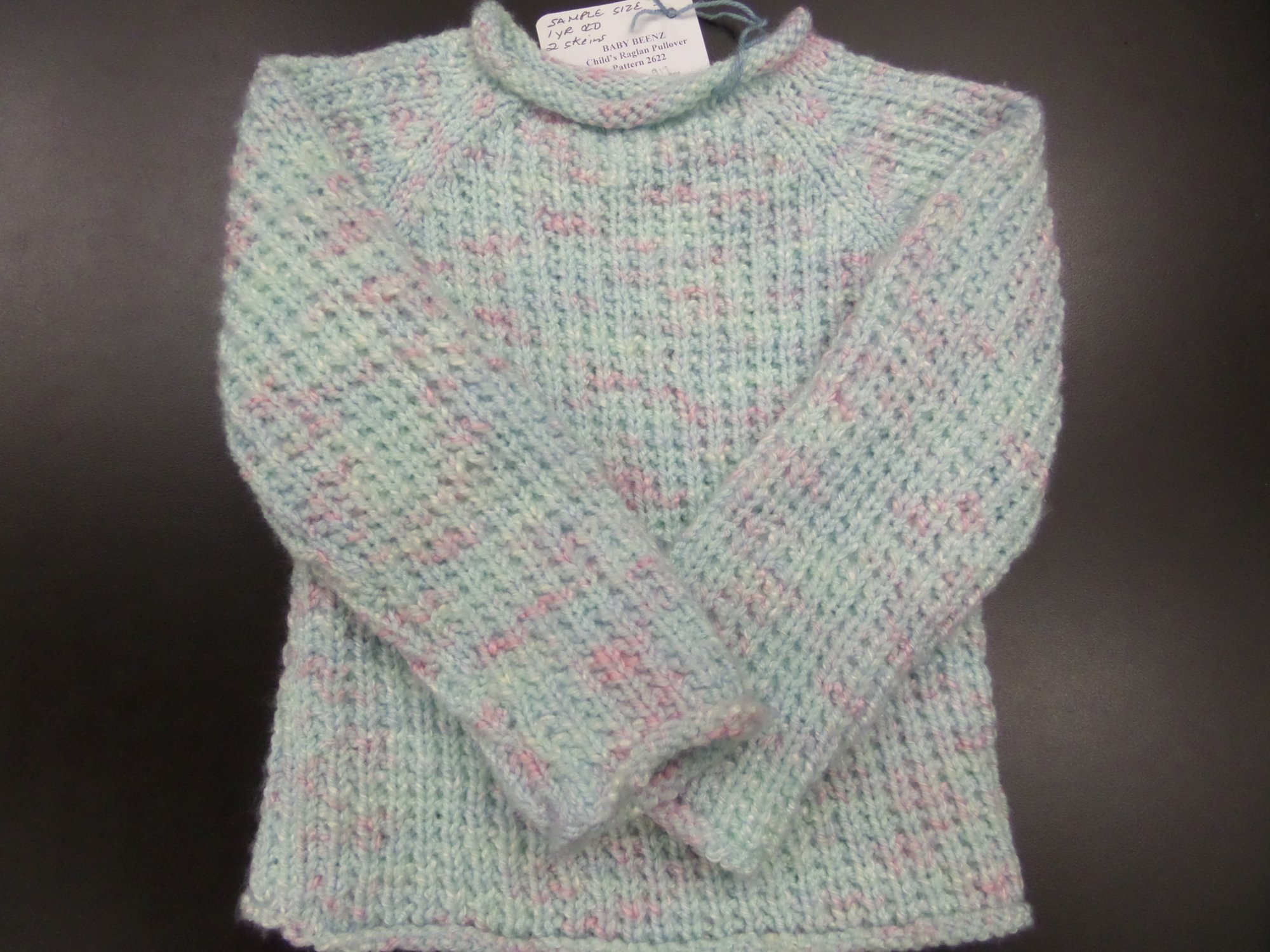 Child's Raglan Pullover model in Baby Beenz from Plymouth