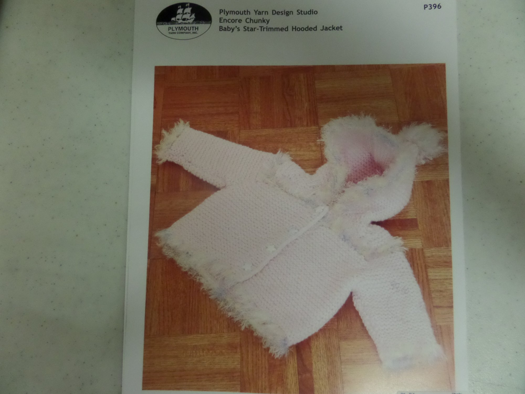 Baby's Star-Trimmed Hooded Jacket pattern P396 from Plymouth