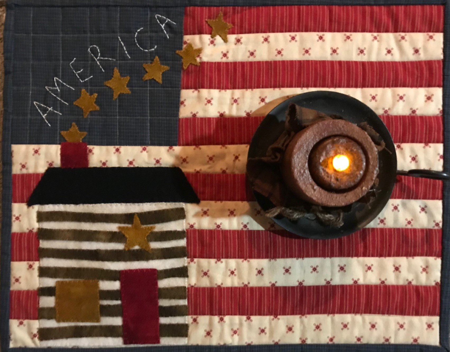 July cabin candle mat