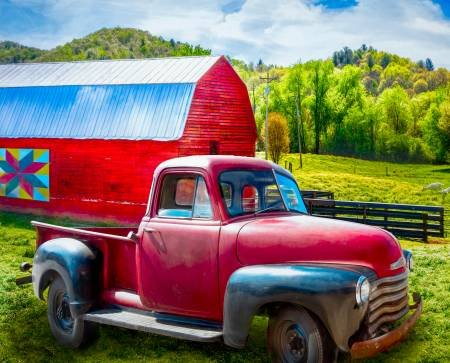 Red truck by Red Barn with quilt