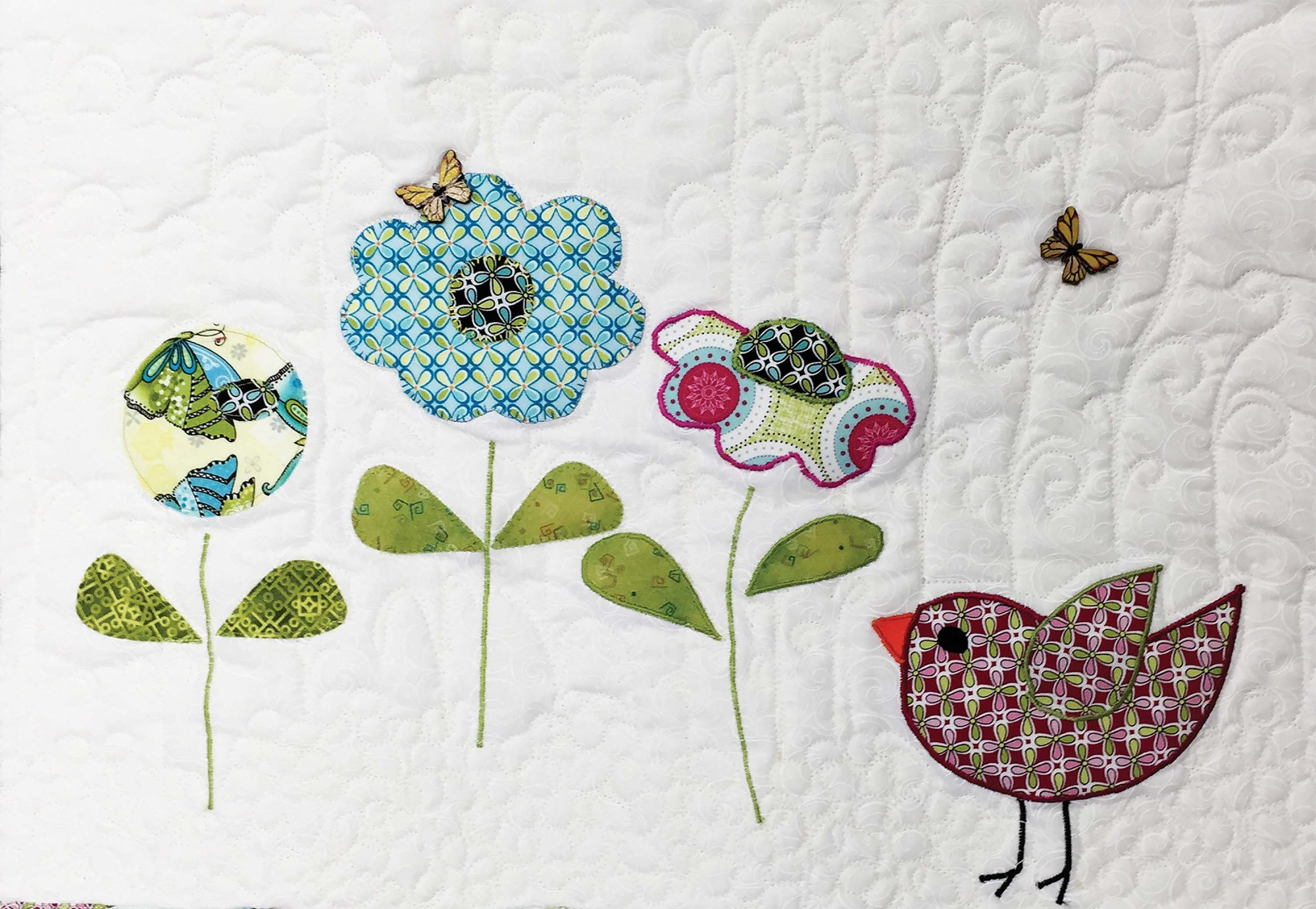 Styles of applique by machine paddi west