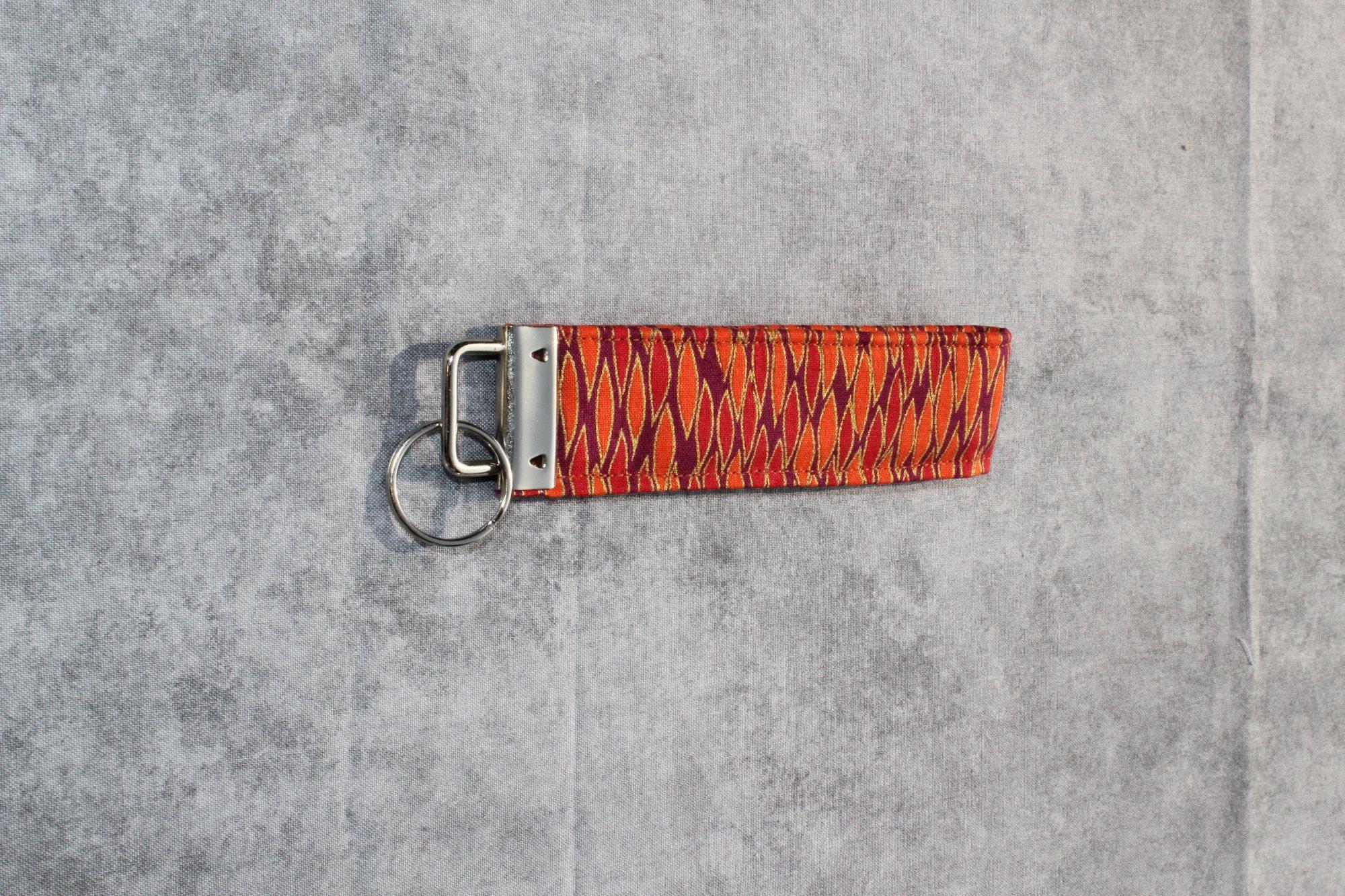 Maroon/Orange/Red/Gold Patterned Short Classic Wristlet
