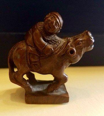 Japanese Netsuke of a man on a water buffalo