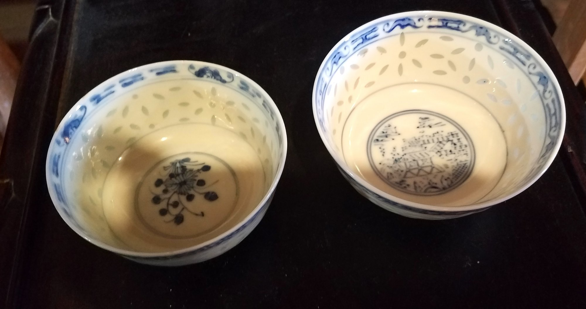 Chinese pair of blue and white translucent rice patern bowls