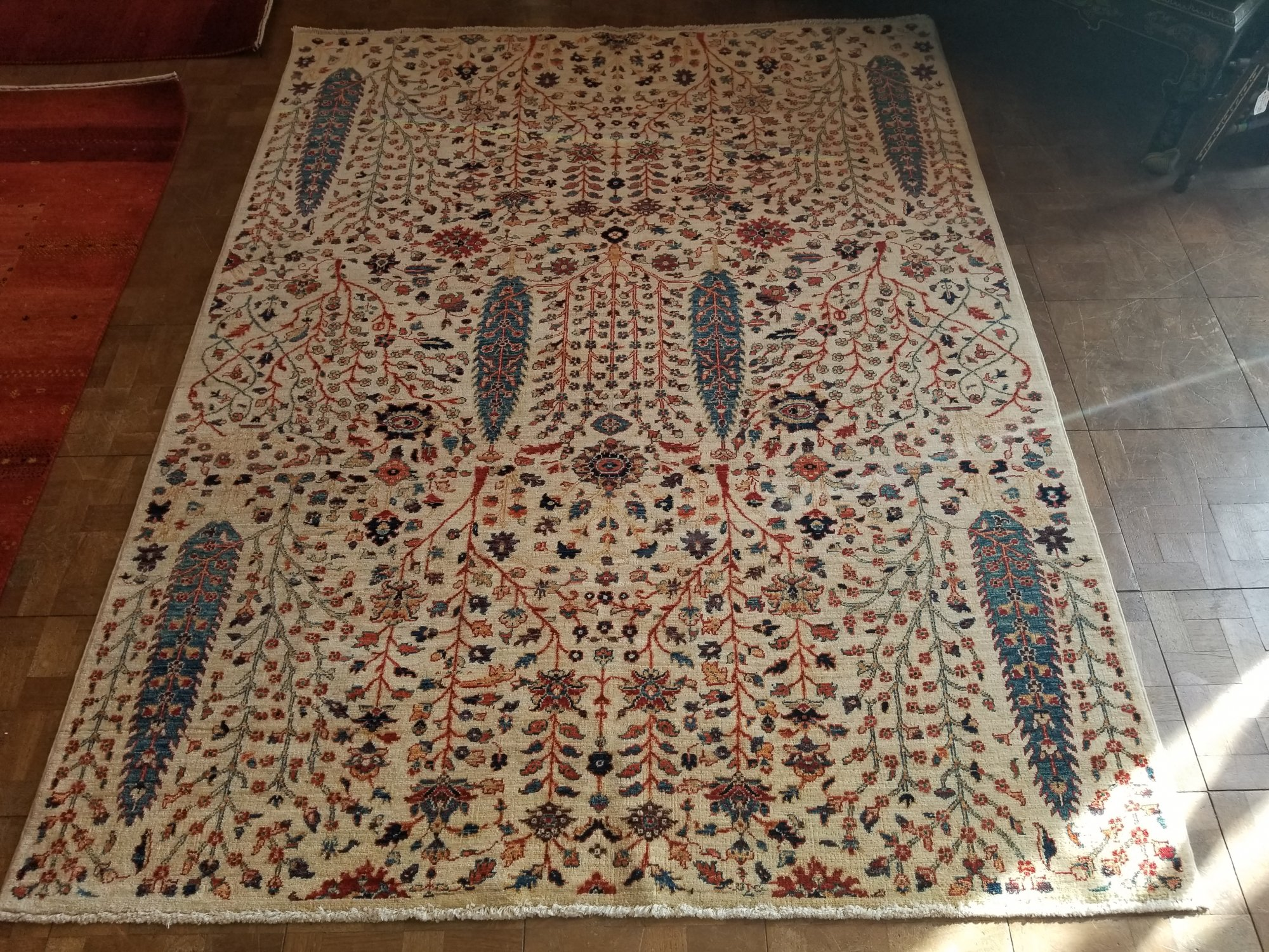 Afghan made Kazak 5' X 6'9 Ivory field with red, black, blue and yellow accents
